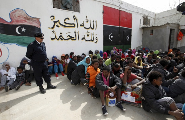 Illegal migrants sit at Abu Saleem detention center in Tripoli